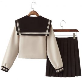 Beige school uniform with dark brown bow
