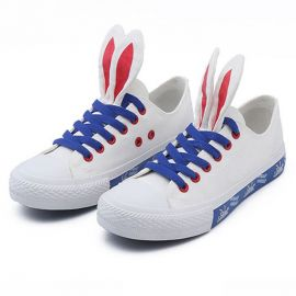 White sneakers with rabbit ears