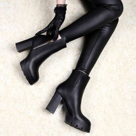 Black heeled leather shoes